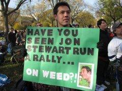 A man holds a pro-marijuana sign.