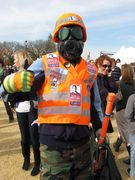 """The """"Swine Flu Avenger"""" makes an appearance in Washington DC, in trademark safety vest, gloves, hard hat, and gas mask."""