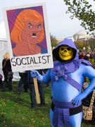 A man dressed as Skeletor from Masters of the Universe portrays He-Man as a socialist (or something), complete with Hitler mustache.