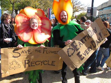 Two people dressed as flowers spread a pro-recycling message.