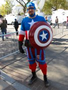 A man dresses in a Captain America outfit.