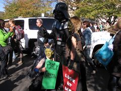 The man in the Darth Vader outfit poses for a photo with other costumed participants.