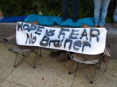 A crudely-painted sign compares hope to fear.