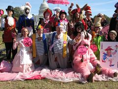 Members of Code Pink pose for a photo following the raising of the pink slip.