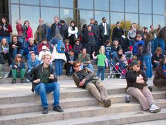 A crowd of people watches the rally from the steps of the Air and Space Museum.