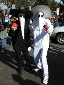 """A pair dresses as the black spy and white spy from Mad Magazine's """"Spy vs. Spy"""" feature."""