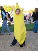 A young girl poses in a banana costume. Turns out that I was the one to break her shyness. Her parents told me that lots of people had wanted her to do the whole Peanut Butter Jelly Time bit, but she only did it after I started doing it first.