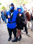 A man dresses as Sub-Zero from the video game Mortal Kombat, while his companion simply wears a blue wig.