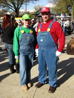 A man and woman dress as Mario and Luigi, respectively. Note, however, that Mario is taller than Luigi in this case, and that neither person is sporting their character's trademark mustache. No word on how well this Luigi can jump, however.