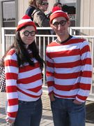 A man and a woman each dressed up as Waldo from the Where's Waldo series of books.