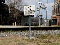 """""""NO TRESPASSING"""" sign for Norfolk Southern railroad tracks."""