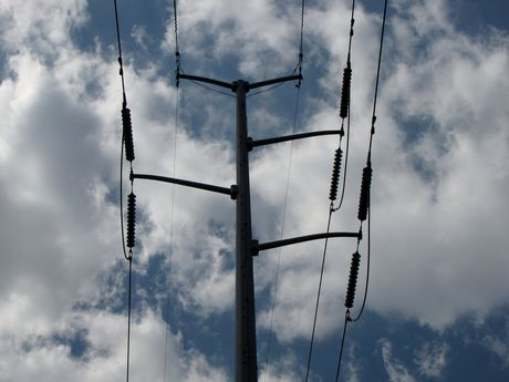 Power transmission lines overhead.