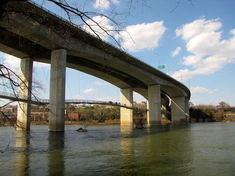 Robert E. Lee Memorial Bridge, with footbridge to Belle Isle suspended beneath. View from Belle Isle.