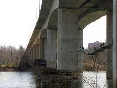 Robert E. Lee Memorial Bridge, with footbridge to Belle Isle suspended beneath. View from Tredegar Street.