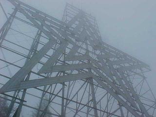 One hundred feet of steel, holding up a giant mass of neon tubing, wires, and more.