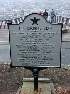 In front of the star sits a historical marker containing facts and figures. The star was erected in 1949 as a symbol of the progressive spirit of Roanoke, the Star City of the South. I think some of the figures that they give for the star are absolutely amazing. The star itself weighs 10,000 pounds, the steel support structure weighs 66,000 pounds, the concrete base weighs 500,000 pounds, and this thing eats 17,500 watts of power. Additionally, it's visible from the air for 60 miles.