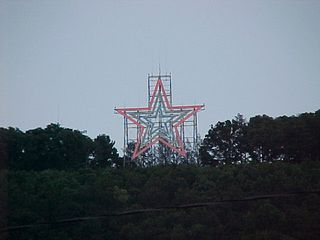 The star's on! Let's go up to the top!