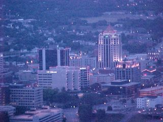 The Roanoke skyline at sunset is a gorgeous sight, with the buildings already lit up before the sun's gone completely down, allowing for a beautiful lighting of building features.