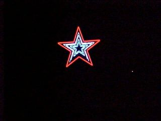 From a gas station at the foot of Mill Mountain, just before you start up the mountain, the star shines brightly, with the exception of the burned-out portion.