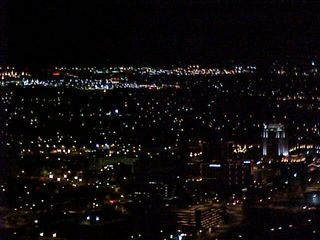 From the vantage point of the overlook, the city is brightly lit and sparkling.