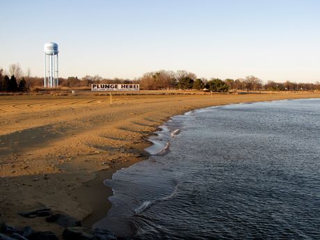 """Western end of South Beach. The water tower and """"PLUNGE HERE"""" sign are visible in the distance."""