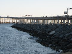 Rock jetty at the west end of South Beach. The Bay Bridge is visible in the distance.