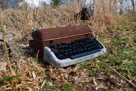 """Remington """"Quiet Riter"""" typewriter on the ground in front of the house"""