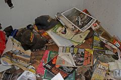 Various outdoor-themed magazines and catalogs, as well as automotive-themed hats, in the southwest corner of the living room