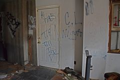 Graffiti in the living room, on and adjacent to the front door