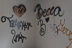 Graffiti in the living room's southwest corner