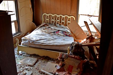 Master bedroom, in the southwest corner of the house. This room was significantly damaged by a tree that fell on the house some time between 2010 and 2014.