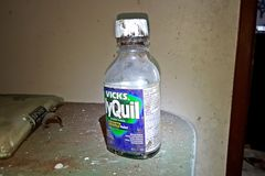 Bottle of NyQuil on a kitchen counter