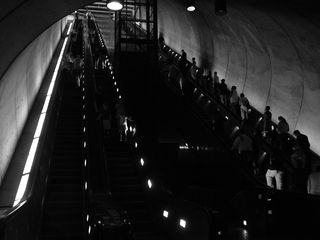Inside Rosslyn station, people enter and exit the station using four escalators.