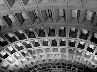 At Federal Triangle, light is reflected off the concrete ceiling.