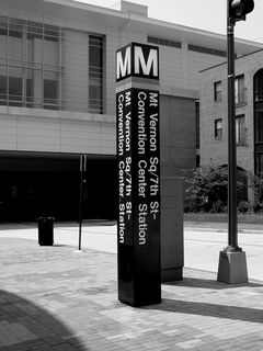 At the Washington Convention Center, a street pylon marks the entrance to the Mt. Vernon Square station.