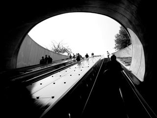Metro customers use the three escalators at the Q Street entrance at Dupont Circle station to enter and exit the station.