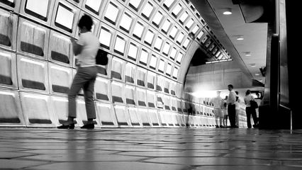 Late at night, there are far less people waiting on the platform than earlier in the day.