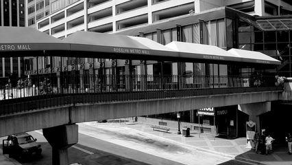 In Rosslyn, an Arlington neighborhood, a skywalk carries pedestrians across North Moore Street from the Metro elevator to Rosslyn Center.