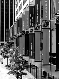 Banners hang from the side of Rosslyn Center, advertising establishments located within the building.
