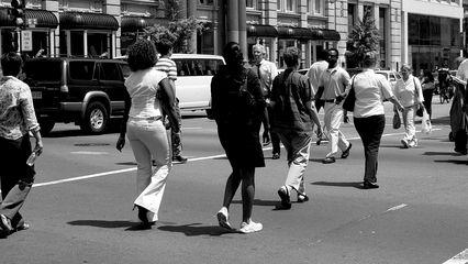 In downtown Washington DC, pedestrians cross the street.