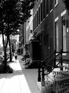 Along 9th Street NW, row houses continue their prevalence.