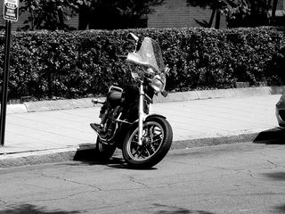 A motorcycle sits parked along 8th Street NW outside the Immaculate Conception Church.