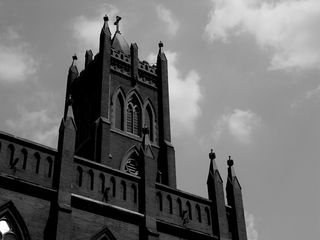 The gothic architecture of the Immaculate Conception Church stands high against the summer sky.