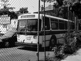 In a parking lot at 8th and N Streets NW, a former CUE bus sits, awaiting its fate.