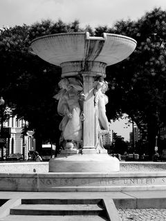 The centerpiece of Dupont Circle is a large fountain featuring three nude classical figures symbolizing the sea, the stars, and the wind.