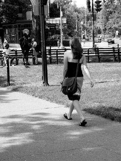 Meanwhile, a woman walks through Dupont Circle.