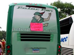"""""""No shame in consensual sex!"""" taped to the back of an intercity bus."""