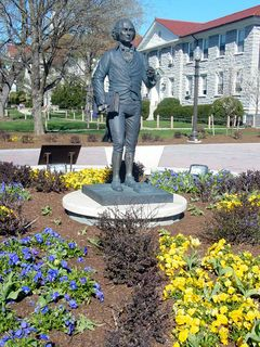Even the area around the statue of James Madison is alive again, with purple and yellow flowers all in a row.