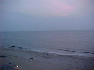 The sun's trying to poke up above the slight cloud cover, but it is not quite there yet...