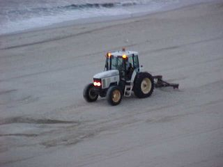 And the sand-smoothing guy continues to smooth out the sand.